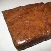 Picture of large, square, chocolate brownie.